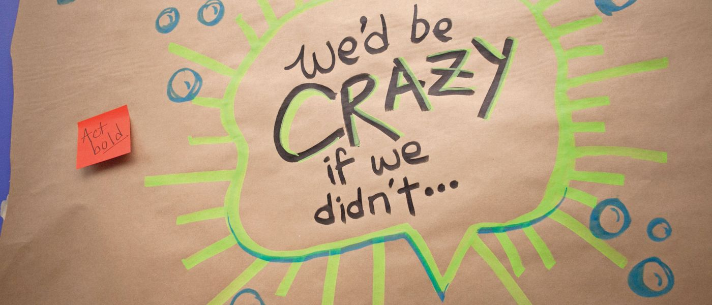 "Illustration on brown butcher paper with colorful post-it notes that says ""We'd be crazy i we didn't..."""
