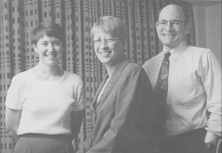 Bush Leadership Fellows Program staff Martha Lee (left) and John Archabal (right) in 1997, with Bush Fellow Susan Showalter ('83), a longtime consultant to the program.