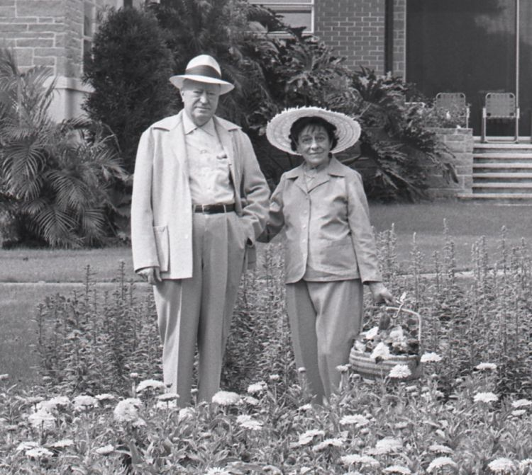 Archibald and Edyth Bush standing in a garden