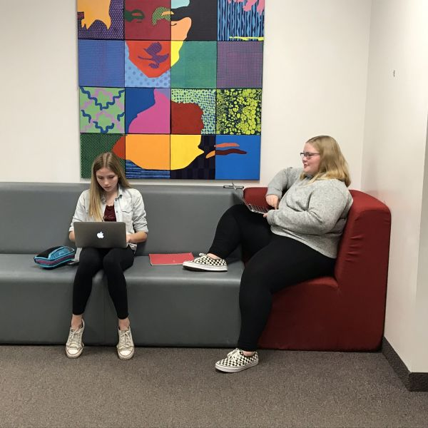 Students work while sitting on colorful couches at Spring Grove School