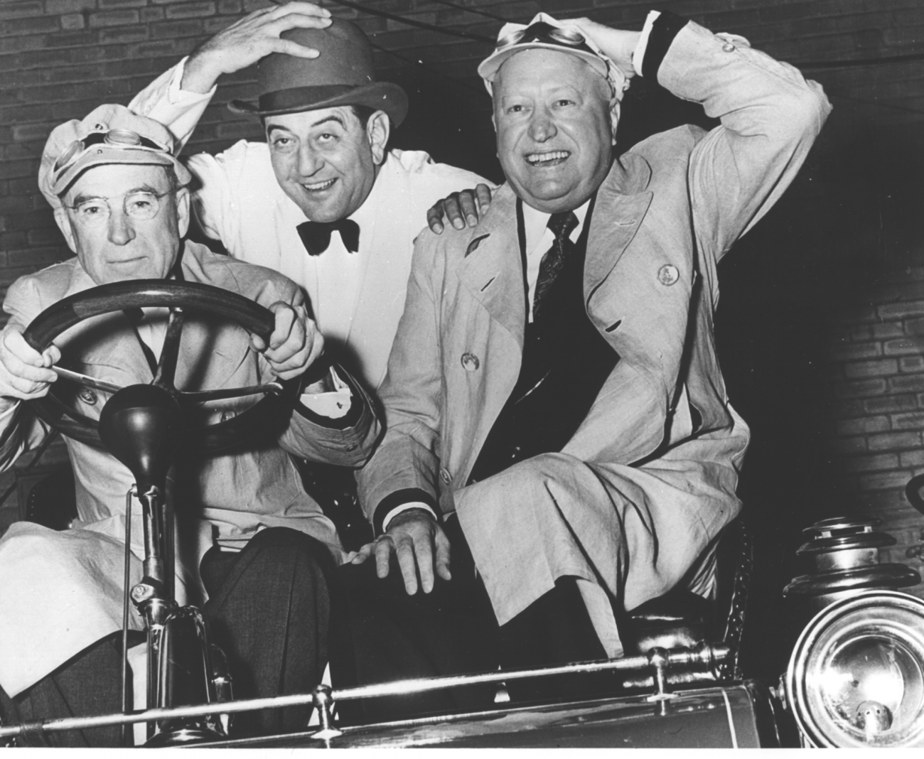 three men in a car