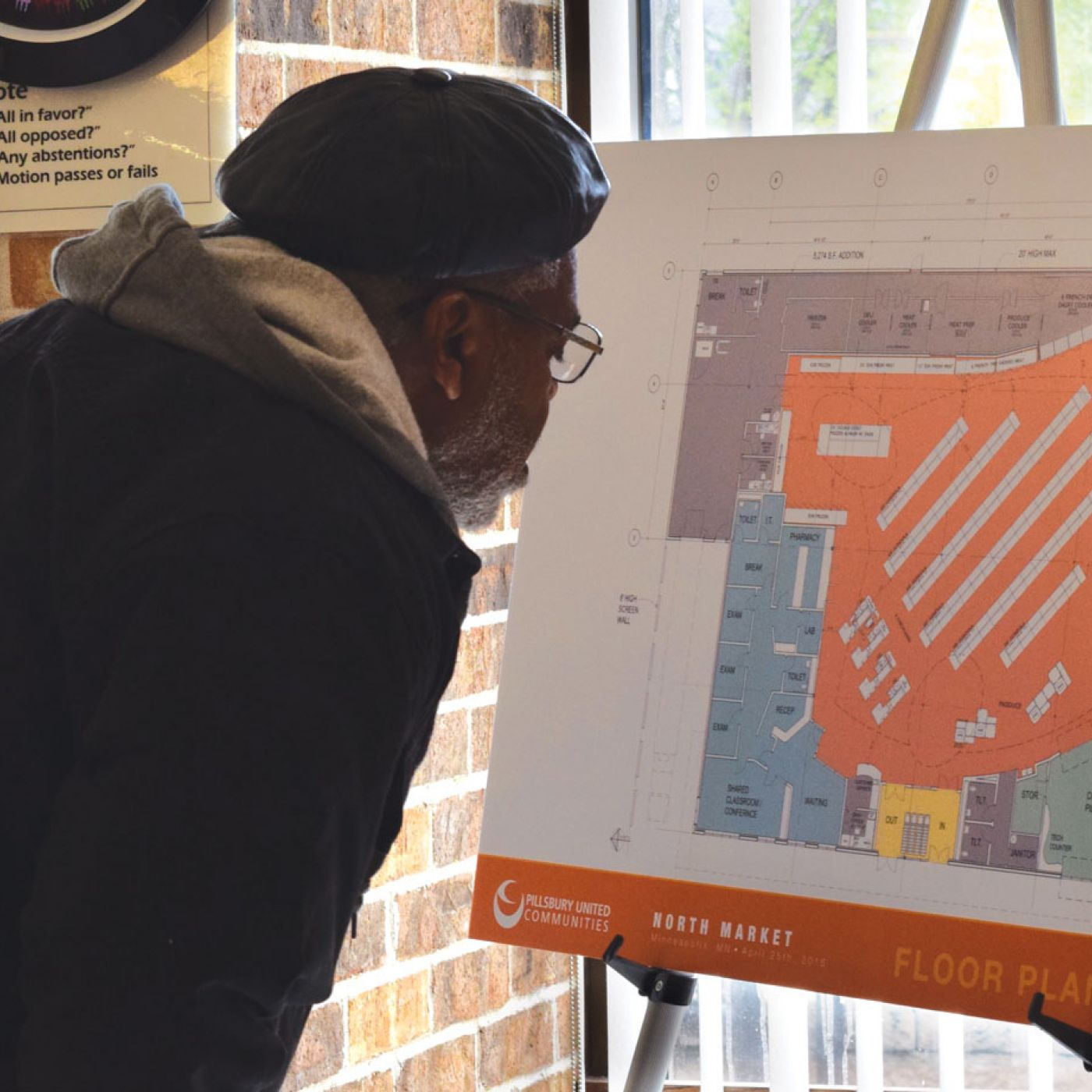 Man reviewing plans for North Market